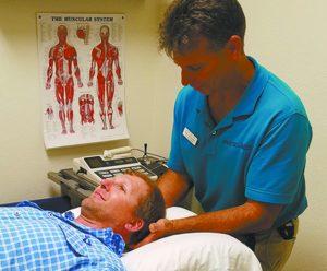 Wim Vergauwen, MPT, CMT, treating a neck patient